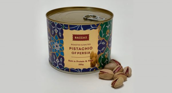 Front view of Bazzaz pistachio in a tin with a side of roasted and salted pistachio
