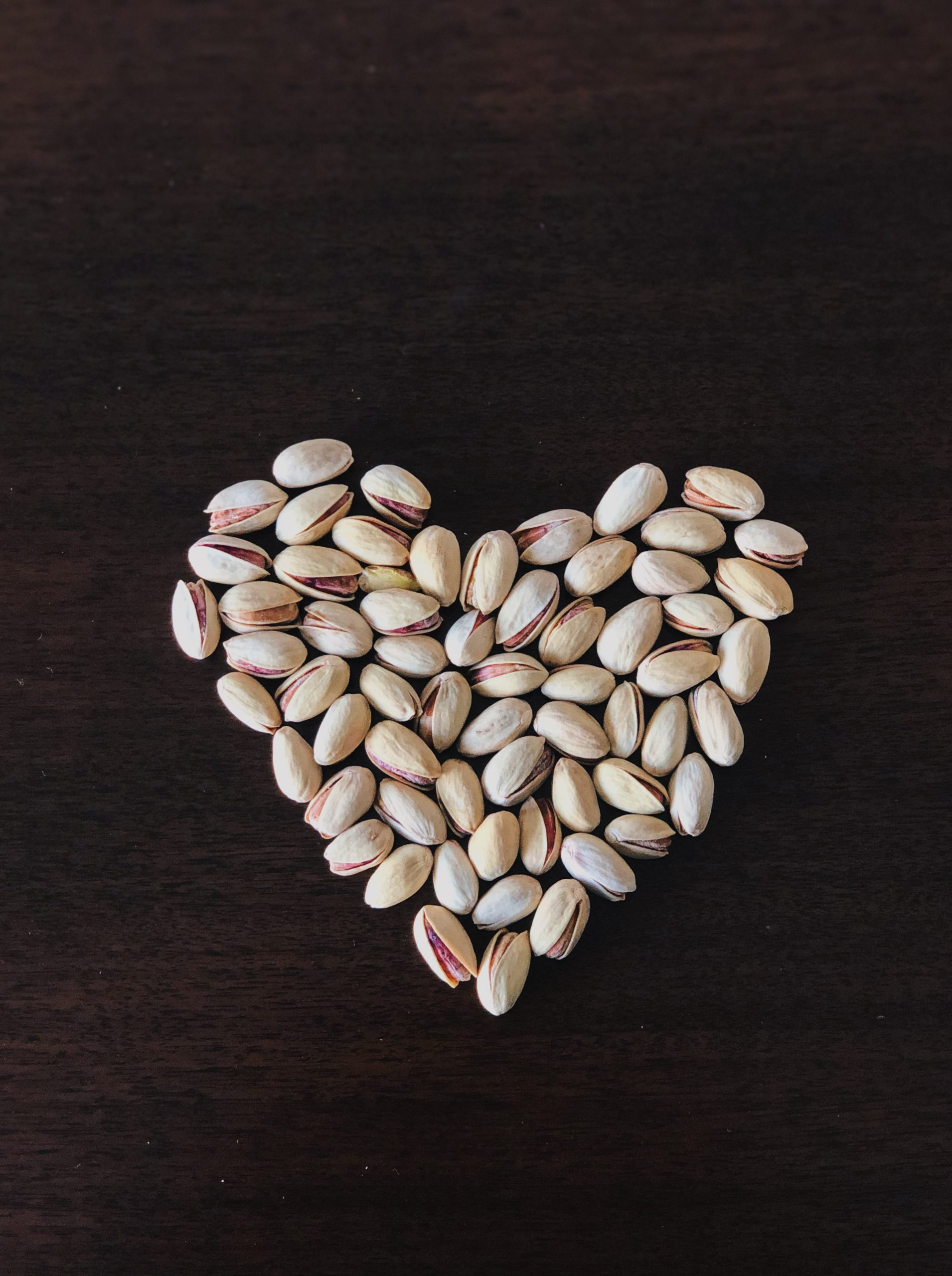 Roasted and salted pistachios in a heart shape