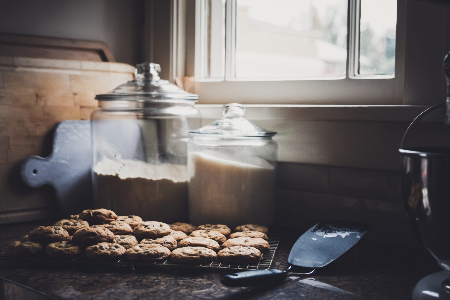 Freshly baked cookies, flour and sugar in kitchen