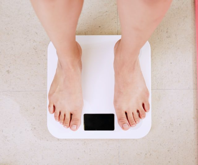 A person on the weighing scale